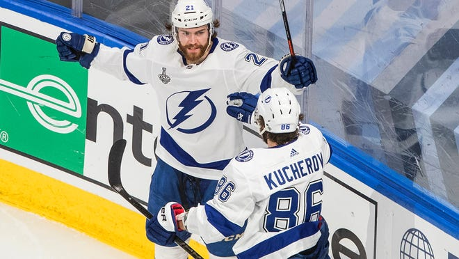 Lightning center Brayden Point (21) celebrates his goal against the Stars with teammate Nikita Kucherov during the second period of Game 4 of the Stanley Cup Final.
