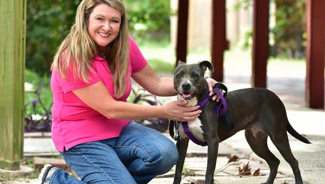 Jennifer Bitner, executive director at the Pensacola Humane Society with Dane.