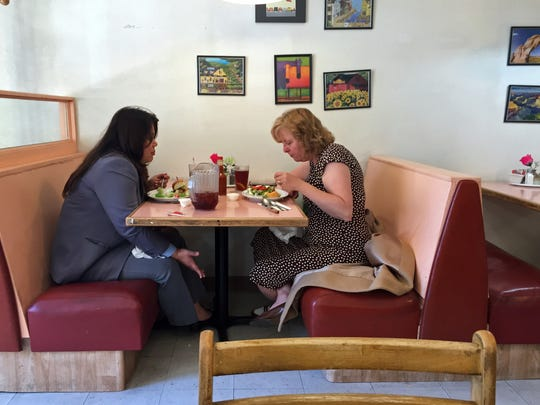 In this file photo, Corey Woo and Laura Kershner enjoy the casual atmosphere at Sang's Café.
