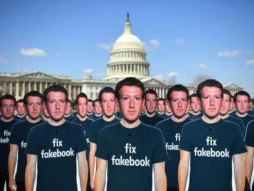 Life-sized cutouts of Facebook CEO Mark Zuckerberg