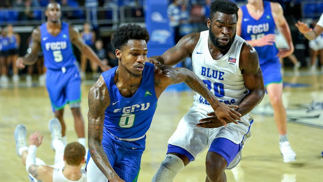 MTSU's Giddy Potts guards Florida Gulf Coast's Brandon Goodwin in their game at Murphy Center on Nov. 21, 2017.