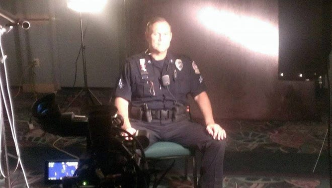 Cpl. Scott Bernal is shown during the filming of a TV show on the Sifrit murder case in 2013.