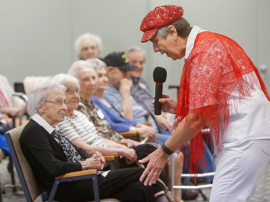 Jenine Bacon, a member of the Happy Plunkers Ukulele Band, sings during Springfield High School Class of 1941's class reunion on Wednesday.