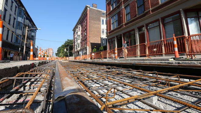 Work proceeds on the rails in July. Cincinnati's streetcar will run 3.6 miles between The Banks and Over-the-Rhine.