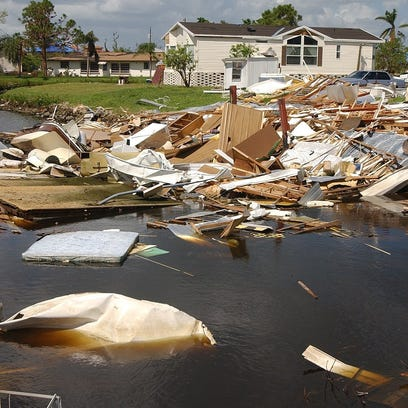DEBRIS FROM MOBILE HOME IN CANAL