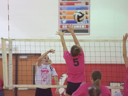 Bucyrus' Shaina Orewiler attempts to block Colonel