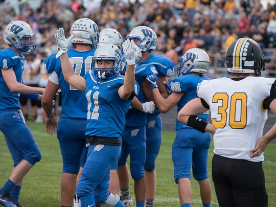 Wynford's Robbie Miller suits up with some of his teammates for one final game.