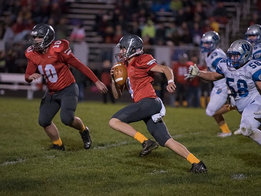 Caleb Stone chases down Buckeye Central's Max Loy.