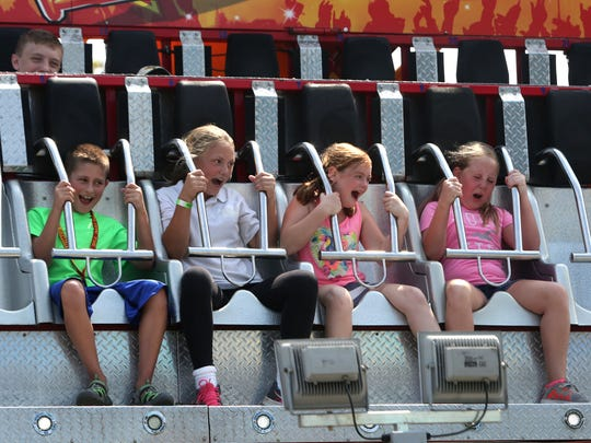 Children scream as they enjoy one of the many rides