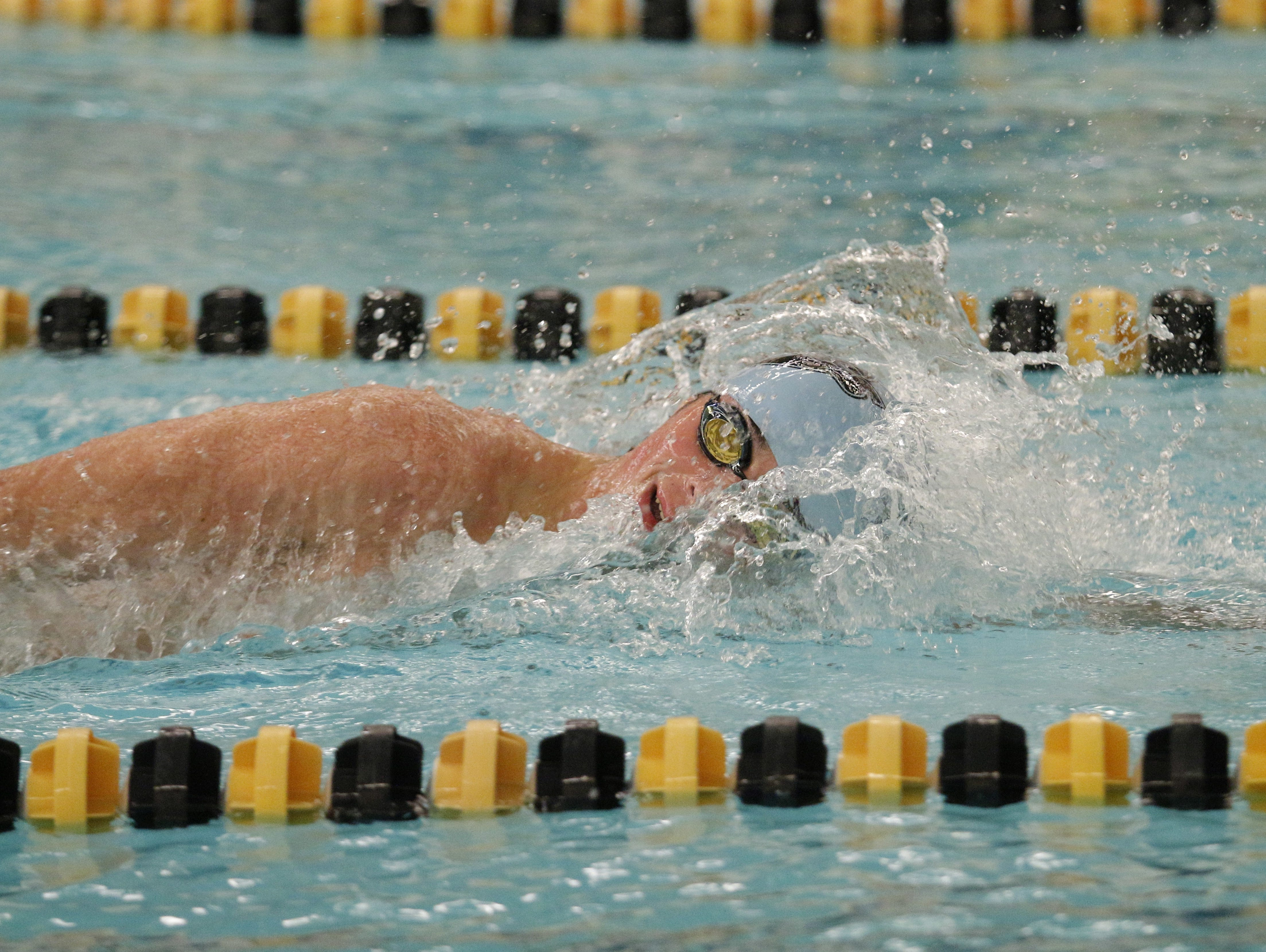 An Okemos swimmer competes in the Waverly Relays on December 7, 2016.