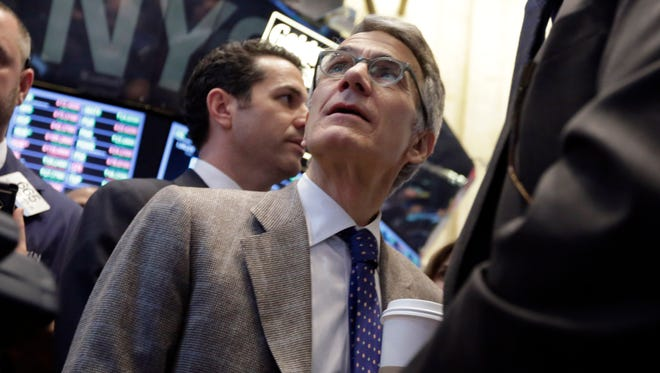 Castlight Health CEO Dr. Giovanni Colella watches as his company's stock is priced during its IPO, on the floor of the New York Stock Exchange on March 14, 2014.