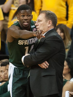 Michigan State guard Eron Harris (14) and coach Tom Izzo talk during a stoppage in play during the second half of MSU's 83-70 loss Tuesday in Iowa City, Iowa.