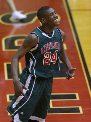 Lawrence North High School senior Daeshon Francis (24) reacts after a slam dunk during the second half of boys varsity basketball action Friday, Jan. 24, 2014, at North Central High School. North Central defeated Lawrence North 56-52.