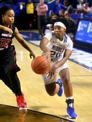 MTSU's Ty Petty (20) passes the ball around Martin Methodist's Markentria Humphrey (35) during an exhibition game at MTSU on Monday, Nov. 9, 2015. Petty is slotted to play point guard.
