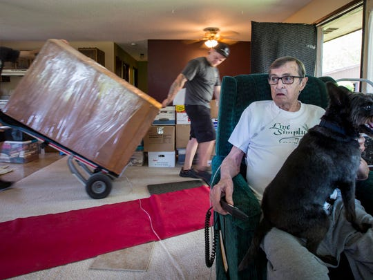 John Tapscott rests in his living room chair as he waits for movers to load belongings Thursday July 14. John and Gaiana Tapscott sold their longtime home in rural Warren County about a year ago with a July 15 move date thinking that John would be dead already.    But John's battle against cancer – despite now being homebound and in hospice care – has not yet taken his life.   Now the couple and their family must move.