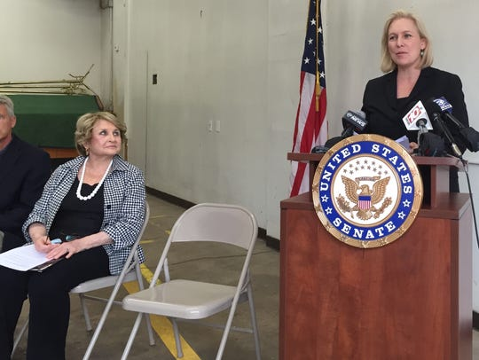 U.S. Sen. Kirsten Gillibrand speaks while U.S. Rep.