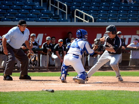 Volcano Vista's Dillon Gassoway is tagged out at home plate by Carlsbad's Eric Hernandez Friday at Isotopes Park.