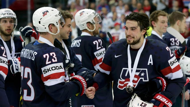 Matt Hendricks and Justin Faulk (R) of the U.S. celebrate after their Ice Hockey World Championship third-place game against the Czech Republic at the O2 arena in Prague, Czech Republic.