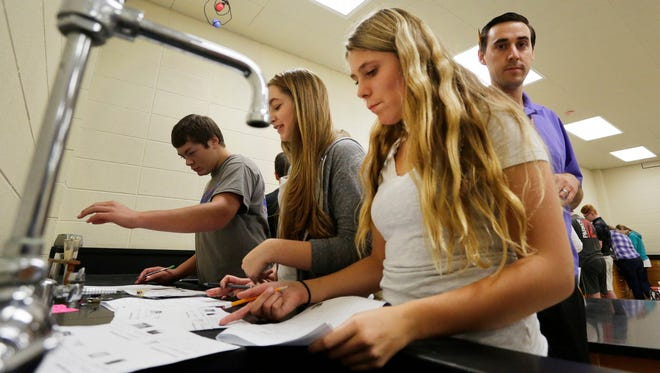 Sheboygan Falls' Caitlin Trumm takes a test in her freshman science class Tuesday, Sept. 29, at Sheboygan Falls. At right is teacher Andrew Jagow.