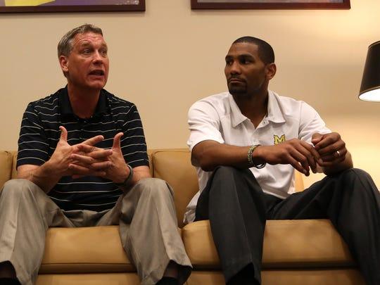 Jeff Meyer, left ,and LaVall Jordan on Wednesday, May 29, 2013, at Center at Crisler Center in Ann Arbor.