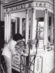 Repainting the ticket kiosk in 1981.