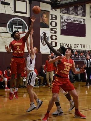Jayson Earle of Bergen Catholic drives during Don Bosco's 61-59 boys basketball victory Tuesday in Ramsey.