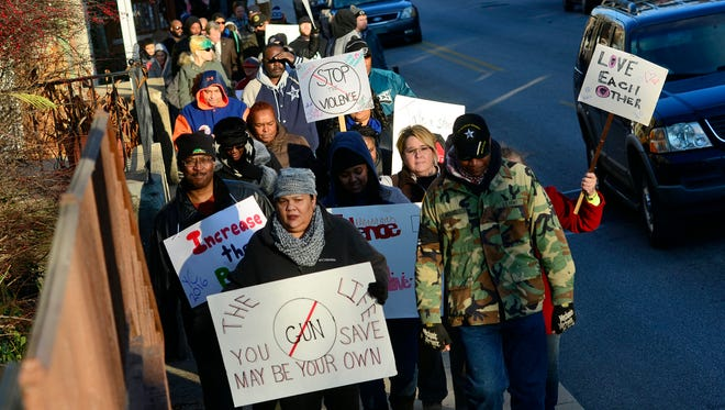 "About fifty people march Salem Avenue area of York City during a ""Stop the Violence"" rally, Sunday, January 3, 2015. (John A. Pavoncello - The York Dispatch)"