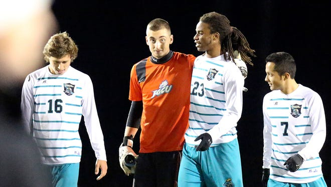 Florida Gulf Coast's Nathan Ingham is surrounded by Coastal players after the first round of the NCAA tournament on Thursday, Nov. 20, 2014. CCU won 1-0. Coastal faces off with Clemson at Coastal on Sunday for round two. Ingham made numerous saves.