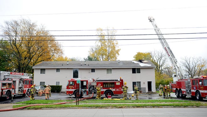 Fire crews from East Lansing and Meridian Township respond to an apartment complex Thursday, Nov. 3, 2016 in Haslett. Crews were originally called out to the complex Wednesday for a fire in the attic and returned Thursday morning after some hot spots in the insulation started smoking.