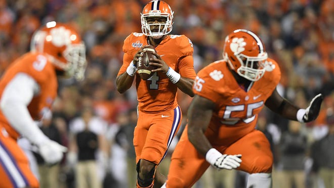 Clemson quarterback Deshaun Watson (4) looks to pass during the 1st quarter against South Carolina on Saturday at Clemson's Memorial Stadium.
