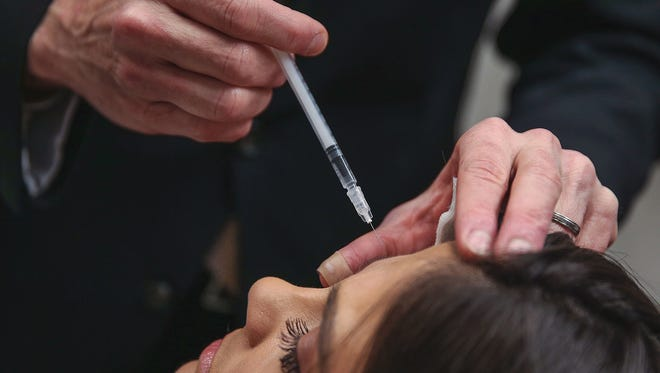Dr. Mark Hamilton, a facial plastic surgeon and reconstructive surgeon, demonstrates a Botox injection at his office in Greenwood, Ind., on  Thursday, March 16, 2017. Botox injections are becoming more popular among Gen Xers and Millenials to smooth out wrinkles and prevent them from deepening with age.