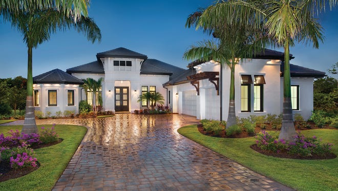The Normandy II, by Stock Custom Homes, is one of 11 estate home models available to tour today.