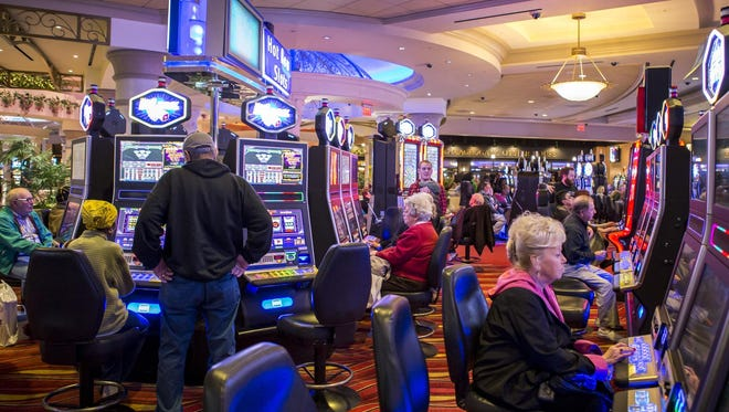 Gamblers play the slots at Dover Downs. The Kent County casino will be sold to a Rhode Island casino operator next year under a deal announced Sunday.