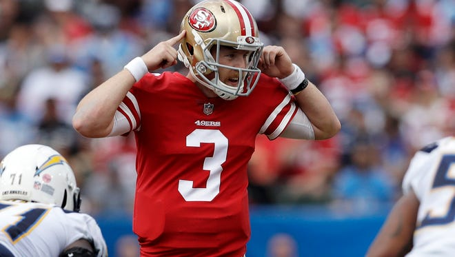 San Francisco 49ers quarterback C.J. Beathard gestures  against the Los Angeles Chargers, Sunday, Sept. 30, 2018, in Carson, Calif.