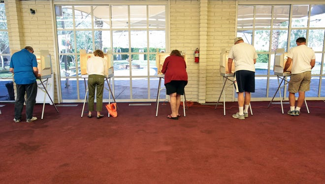 Palm Desert voters cast their ballots inside Karns Hall on at St. Margaret's Episcopal Church on Tuesday, November 4, 2014.  In addition to state ballot items, Palm Desert voters also weighed in on city council seats and an increase to the city's transient occupancy tax.