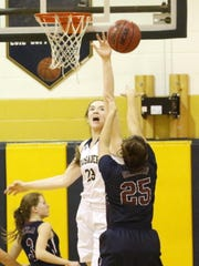 Notre Dame's Mary Foster tries to block a shot by Watkins