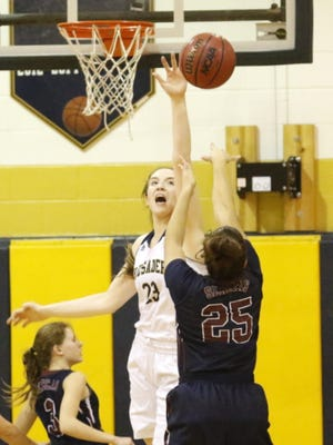 Notre Dame's Mary Foster tries to block a shot by Watkins Glen's Mariah Gonzalez last season at Notre Dame High School.