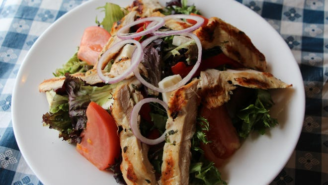Tuscan Salad with char-grilled chicken, served with balsamic vinaigrette.