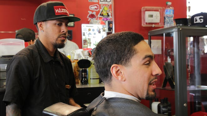 Danny Garcia gets a trim from his barber, in the shop that the fighter owns in Philadelphia. (Photo: Greg Presto, USA TODAY Sports