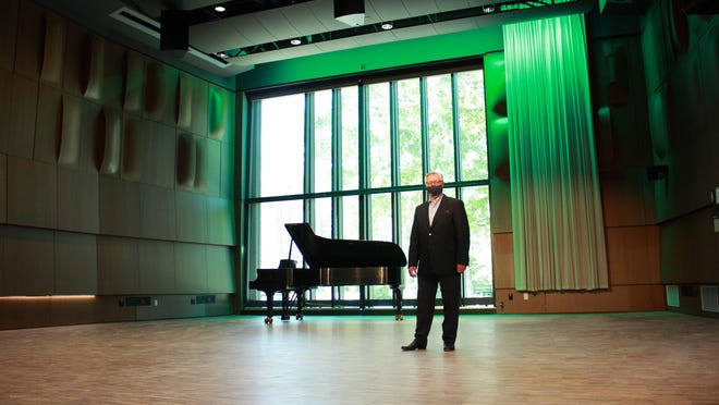 James Forger, Dean of the College of Music, stands masked in Murray Hall.