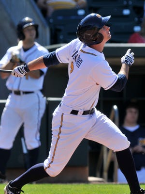 The Montgomery Biscuits' Joey Rickard (7) watches his hit during their game with the Mississippi Braves at Riverwalk Stadium on Sunday, April 20, 2014, in Montgomery, Ala..