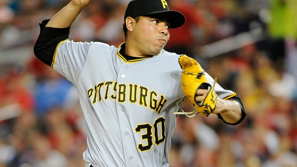 Pittsburgh Pirates relief pitcher Jeanmar Gomez (30) throws to the Washington Nationals during the fourth inning Aug. 15 at Nationals Park. Credit: Brad Mills-USA TODAY Sports