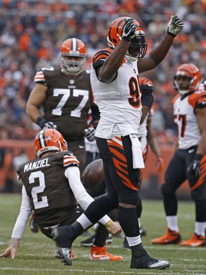 Bengals defensive end Wallace Gilberry shows the money sign after sacking Browns quarterback Johnny Manziel in the first quarter.