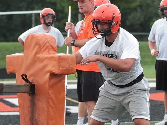 AJ Epenesa of Edwardsville battles the tackling dummy