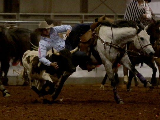 in this file photo, Justin Shaffer leaves his horse and takes down the steer during the Professional Rodeo Cowboys Association Rodeo at the J.S. Bridwell Agricultural Center. This year's event will be 7 to 10 p.m. April 20 and 21 at Kay Yeager Coliseum.