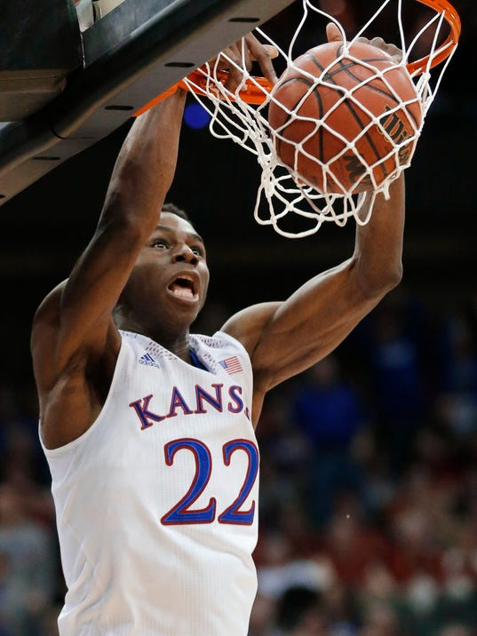 FILE - In this March 13, 2014 file photo, Kansas guard Andrew Wiggins dunks during the second half of an NCAA college basketball game against Oklahoma State in the quarterfinals of the Big 12 Conference men's tournament in Kansas City, Mo. Wiggins is a possible pick in the 2014 NBA Draft, Thursday, June 26, 2014 in New York. (AP Photo/Orlin Wagner, File)