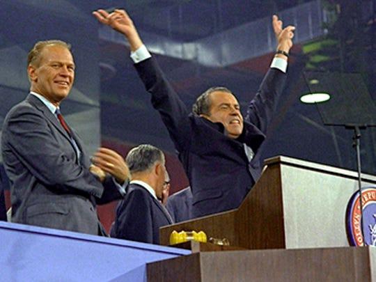 Republican presidential nominee Richard Nixon raises