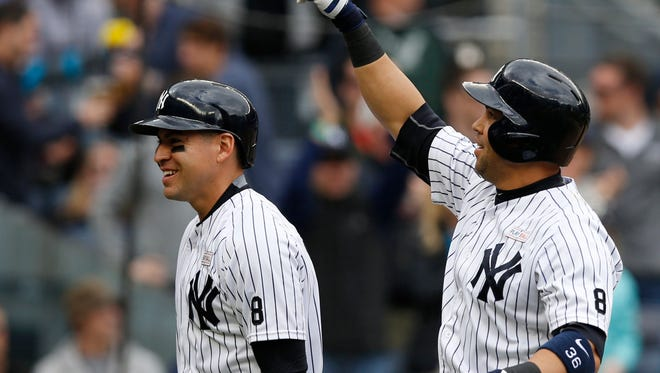 New York Yankees designated hitter Carlos Beltran, right, reacts to the crowd after hitting a two-run, home run during the sixth inning of a baseball game against the Chicago White Sox in New York, Sunday, May 15, 2016. New York Yankees center fielder Jacoby Ellsbury, left, scored on the home run, which was the 400th of Beltran's career.