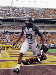 Jan 1, 2015; Orlando, FL, USA; Missouri Tigers wide receiver Bud Sasser (21) runs into the end zone after a 25-yard touchdown catch against the Minnesota Golden Gophers in the first half of the 2015 Citrus Bowl at Florida Citrus Bowl. Mandatory Credit: David Manning-USA TODAY Sports