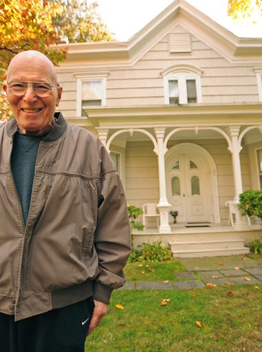 Charles Kaufman poses by his 150-year-old house he moved into in 1963, on Thursday October 24. He spent 50 years investigating the hidden treasures of his house and discovered few historical artifacts.